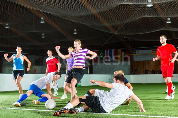 Team playing football or soccer sport indoor Stock photo © Kzenon
