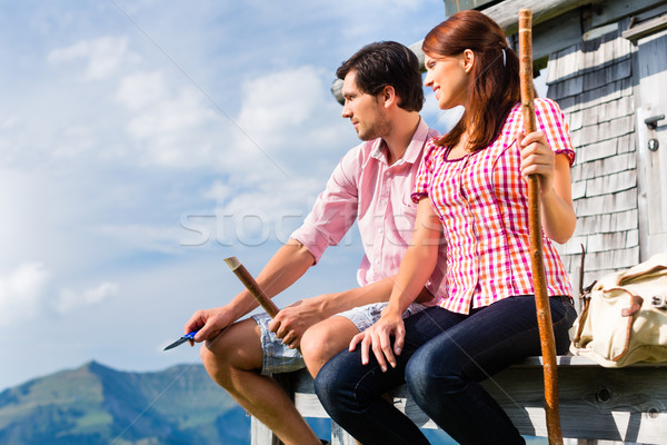 Alp mountains - Man and woman sitting at cabin Stock photo © Kzenon