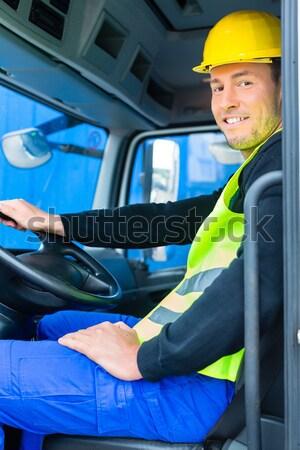 crane operator driving with truck of construction site Stock photo © Kzenon
