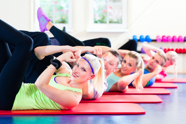 fitness people in gym doing crunches Stock photo © Kzenon