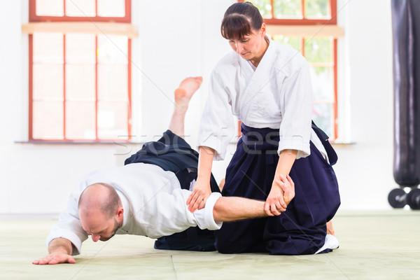 Férfi nő harcol aikidó küzdősportok iskola Stock fotó © Kzenon