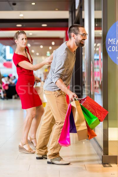 Couple at shop window in mall shopping Stock photo © Kzenon