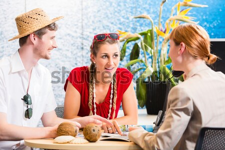 Stock photo: Man and woman recommending travel agency