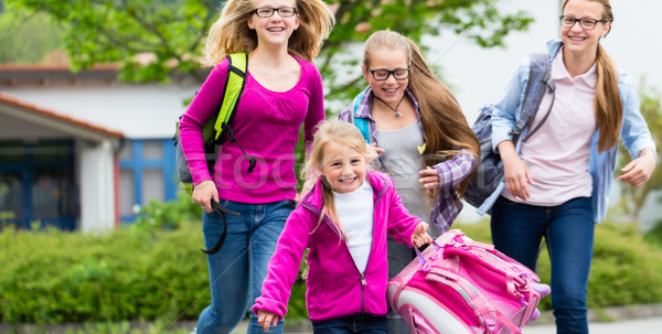 Pupils or students at schoolyard in recess Stock photo © Kzenon