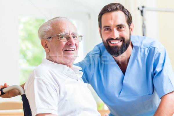 Senior man and nurse in rest home Stock photo © Kzenon