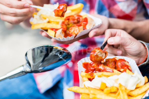 Currywurst and french fries on scooter Stock photo © Kzenon