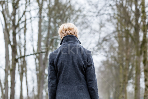 Unhappy woman having walk in winter Stock photo © Kzenon