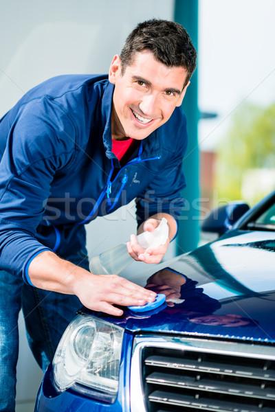Feliz homem olhando câmera depilação com cera azul Foto stock © Kzenon