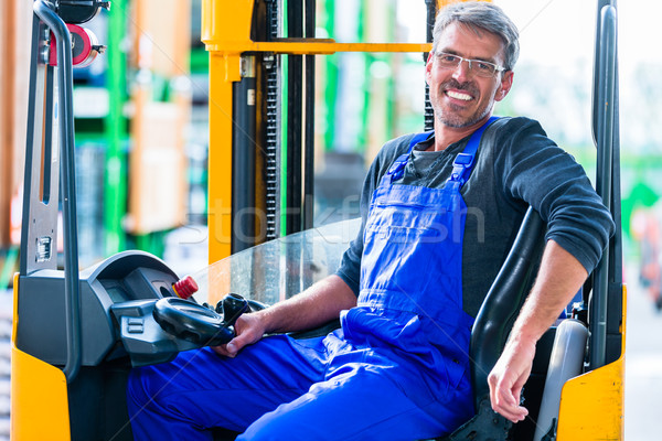 Home improvement store clerk driving forklift Stock photo © Kzenon