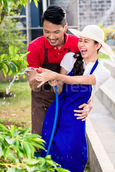 Fiatal ázsiai pár nevet locsol megművelt Stock fotó © Kzenon