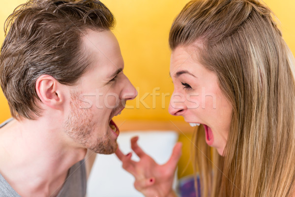 Young married couple, woman and man, in furious fight staring an Stock photo © Kzenon