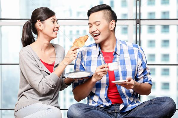 Young asian couple having breakfast together Stock photo © Kzenon