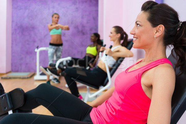 Fit woman listening to fitness instructor with sense of humor du Stock photo © Kzenon