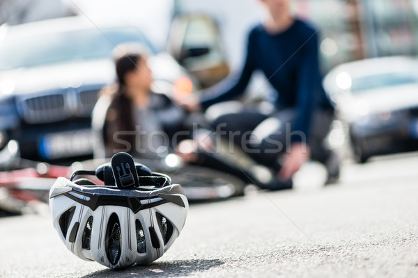 Close-up of a bicycling helmet fallen down on the ground after a Stock photo © Kzenon