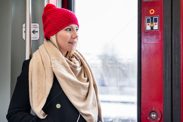 Woman standing inside a train near the door waiting for arrival Stock photo © Kzenon