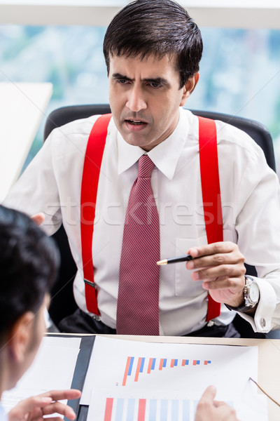 Supervisor talks to subordinate professional in office building Stock photo © Kzenon