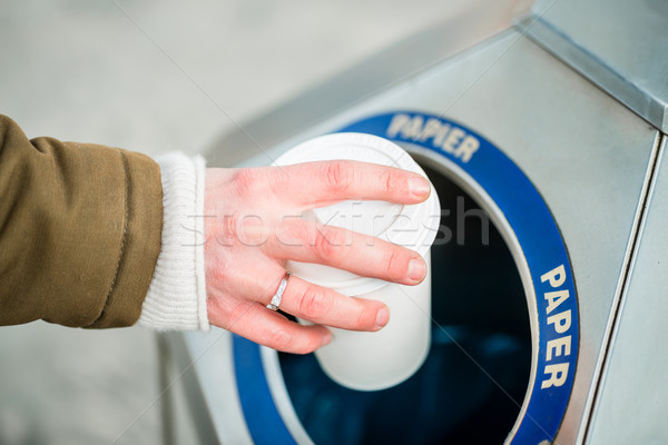 Woman using waste separation container throwing away coffee cup Stock photo © Kzenon
