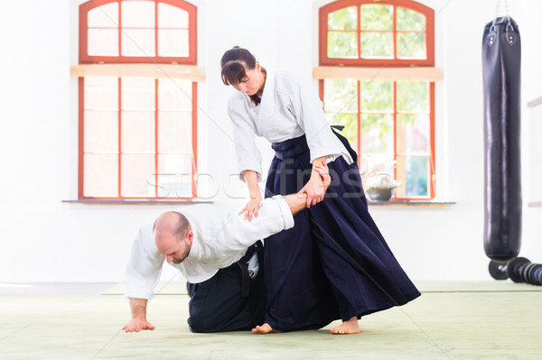 Man and woman fighting at Aikido martial arts school Stock photo © Kzenon