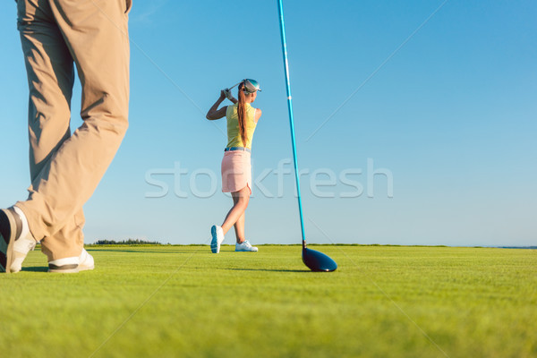 Female professional golfer hitting a long shot during a challenging game Stock photo © Kzenon
