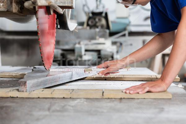 Stone mason woman measuring stone plate for sawing  Stock photo © Kzenon