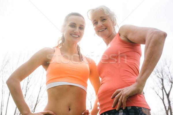 Senior and young woman doing sport outdoors Stock photo © Kzenon