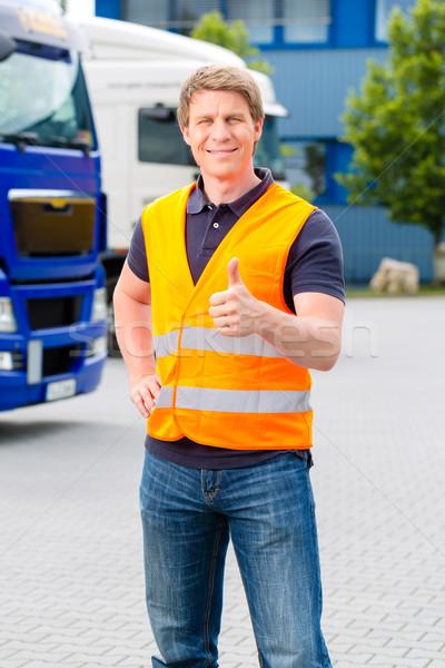 Forwarder in front of trucks on a depot Stock photo © Kzenon
