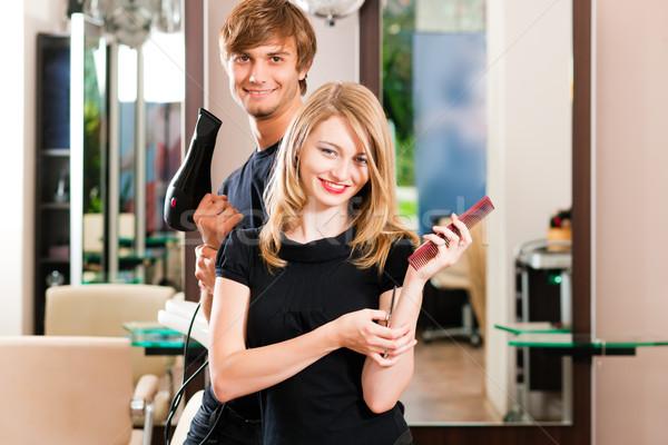 Male and female hairdresser Stock photo © Kzenon
