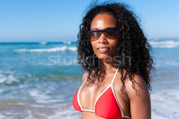 魅力のある女性 ビキニ ビーチ 立って 太陽 眼鏡 ストックフォト © Kzenon