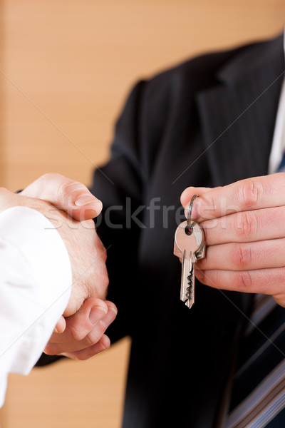 Business Handshake with giving keys Stock photo © Kzenon