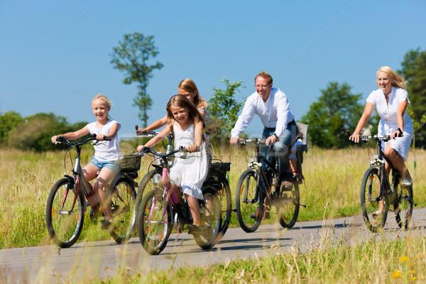 Family cycling outdoors in summer Stock photo © Kzenon
