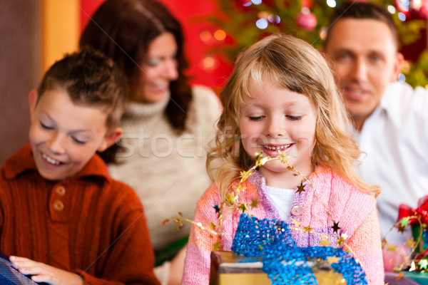 Christmas - family with gifts on Xmas Eve Stock photo © Kzenon