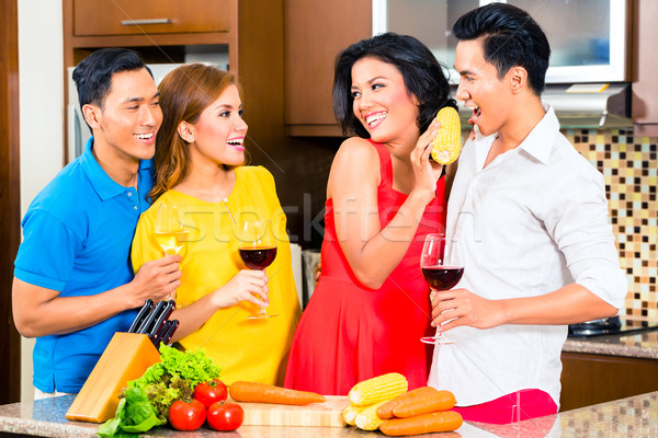 Asian friends cooking  for dinner party Stock photo © Kzenon