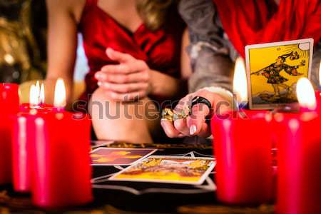 fortuneteller during Session with tarot cards Stock photo © Kzenon