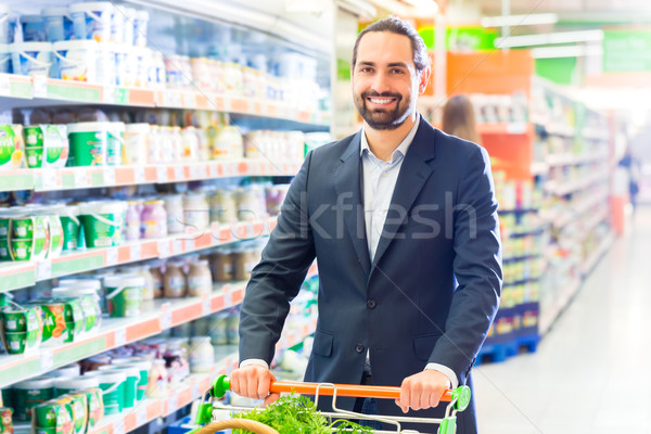 Customer with pushcart in supermarket Stock photo © Kzenon