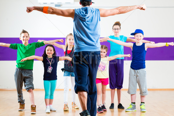 Dance teacher giving kids Zumba fitness class  Stock photo © Kzenon
