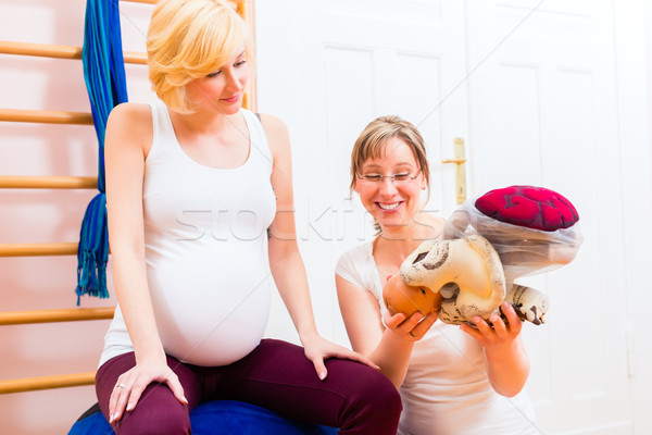 Midwife giving prenatal care for pregnant mother Stock photo © Kzenon