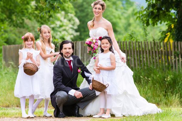 Menyasszonyi pár esküvő koszorúslány gyerekek szeretet Stock fotó © Kzenon