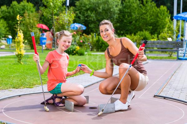 Aile oynama minyatür golf yaz çocuk Stok fotoğraf © Kzenon