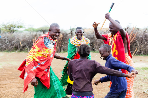 Massai family celebrating and dancing Stock photo © Kzenon