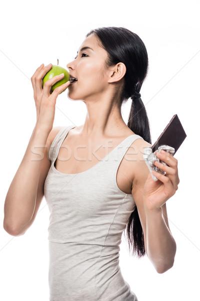 Attrattivo asian donna dieta sana mordere fresche Foto d'archivio © Kzenon