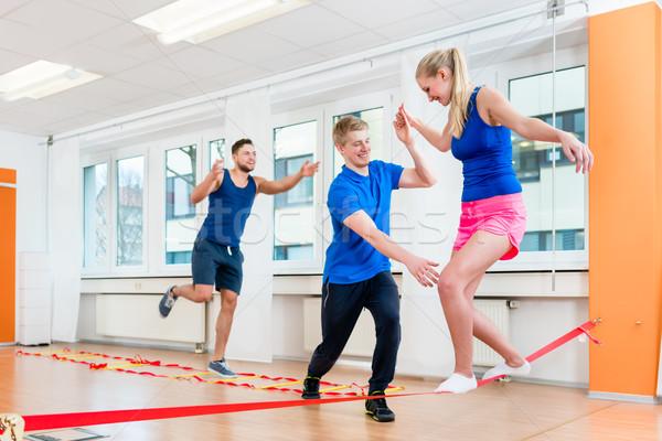 Oefenen gymnasium man vrouwen Stockfoto © Kzenon