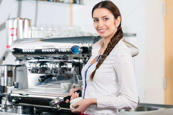 Portrait of young waitress smiling near the coffee machine  Stock photo © Kzenon