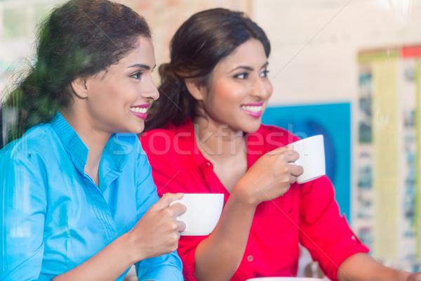 Two Indian girls having espresso Stock photo © Kzenon