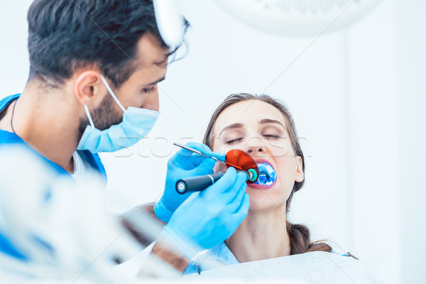 Young woman during innovative oral treatment Stock photo © Kzenon