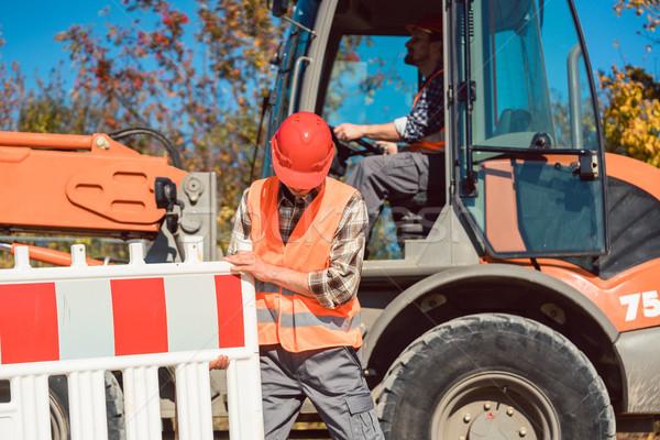 Worker setting up earthworks construction site Stock photo © Kzenon