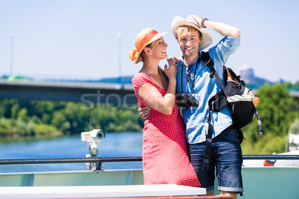 Couple on river cruise wearing sun hats in summer Stock photo © Kzenon