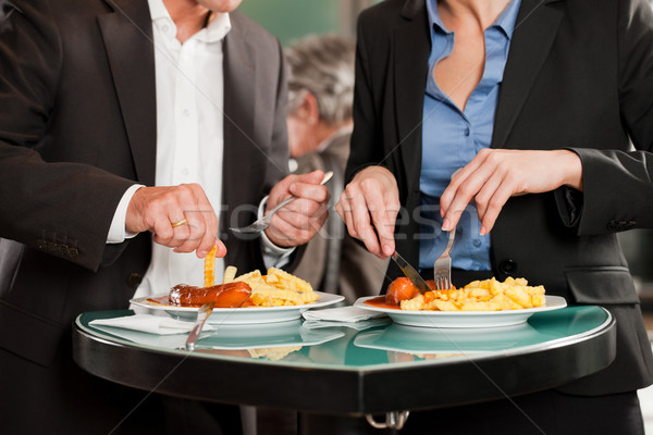 Business People Eating Delicious Food Together Stock photo © Kzenon