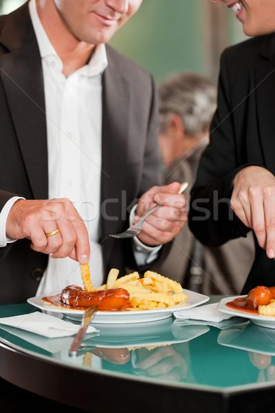 Comer delicioso comida junto masculina Foto stock © Kzenon