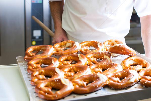 Male baker in bakery Stock photo © Kzenon