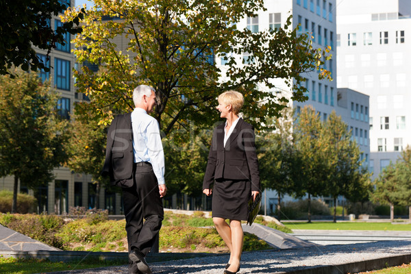 Business people greeting outdoors Stock photo © Kzenon